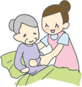 おばあさんをゆっくりと起こす介護士さん