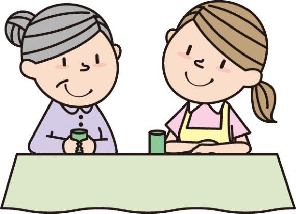 高齢者と話す介護士のイラスト